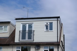 Loft conversion with dormer cladded with weather board