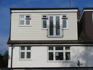 Loft conversion with dormer cladded with weather board1