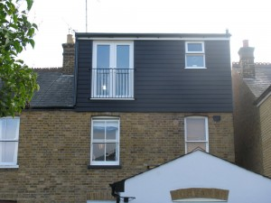 Loft conversions with dormer cladded with weather board